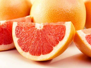 Couple of delishes grapefruits isolated on white. Clipping path included in the file!